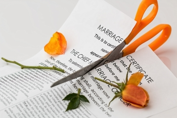 Pro Se Divorce Represented by Cutting Marriage Certificate in Half